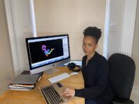 Postdoctoral researcher Jerelle Joseph at her computer