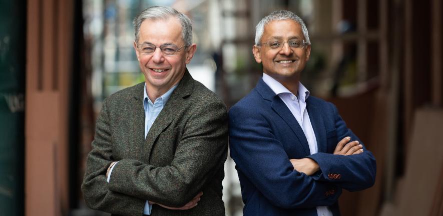 David Klenerman and Shankar Balasubramanian standing back to back facing camera
