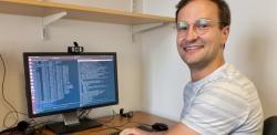Image of Dr Christoph Schran sitting at his desk